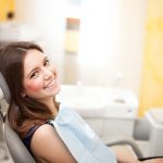 Happy Patient Smiling in Dental Chair